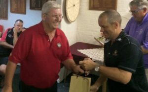Phil Conway accepts a trophy for winning the NEDGA's over 55's net category.