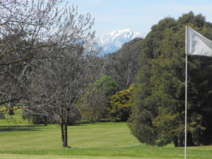 WINTER GOLF. A snow covered Mt Buller from the 9th Green.